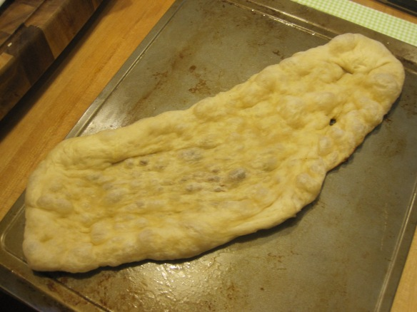 Usually when you open the grill the dough has bubbled an absurd amount then it collapses to this on the way in.  The shape should be blamed on me, not the grill