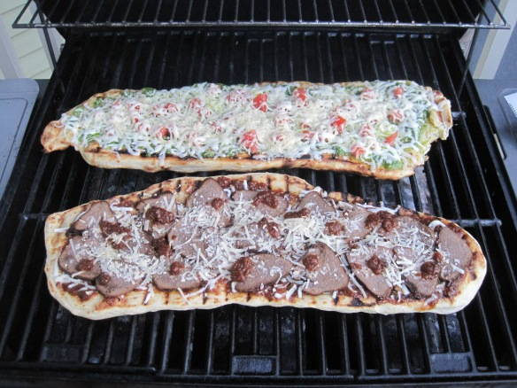 This foto was a huge point of anxiety for me.  The dough can only be on the grill for a couple minutes and that time needs to be trapping enough heat to melt the toppings.  So, normal overreaction from me